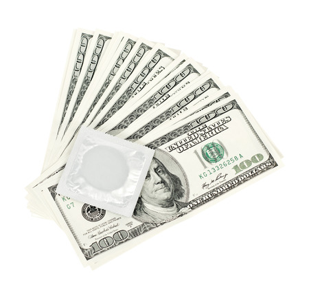 USA dollars with condom,  isolated on white background photo