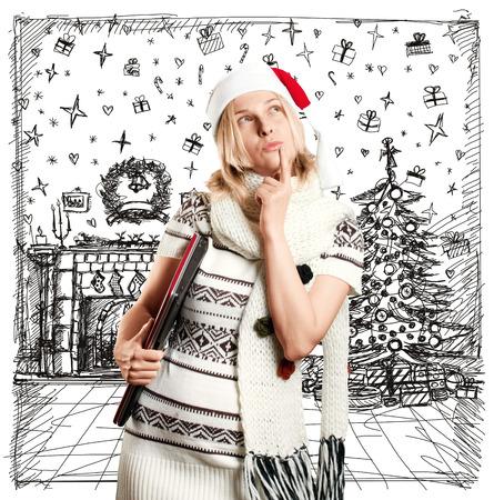 クリスマスを待ちながらスケッチ背景のサンタの帽子を持つ女性