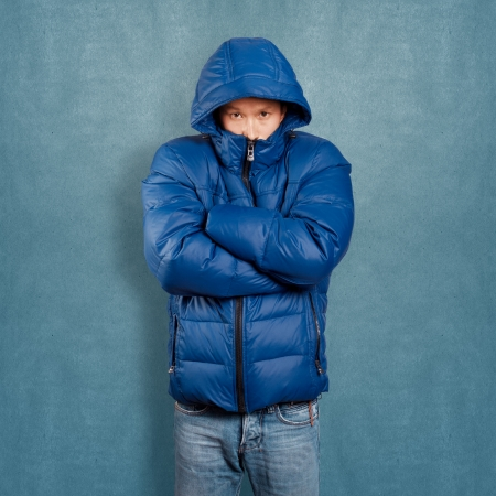 asian man face: Asian man in blue down-padded coat
