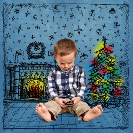 Cute baby with cell looking for something in Christmas photo