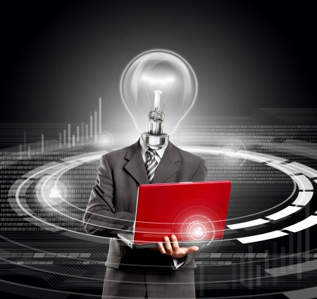 Idea concept. Business lamp head man with laptop in his hands photo