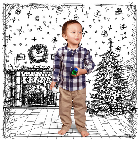 Cute baby in Christmas, standing with toys in his hands photo