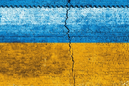 Cracked brick wall as Ukraine flag, symbolize the recent people strike Stock Photo - 24313842