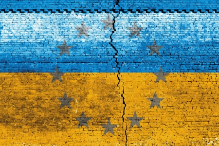 Cracked brick wall as Ukraine flag, symbolize the recent people strike Stock Photo - 24313846