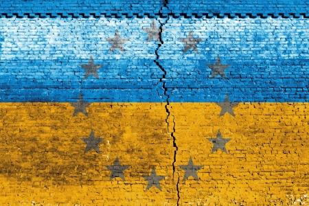 Cracked brick wall as Ukraine flag, symbolize the recent people strike Stock Photo - 24313846