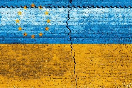 Cracked brick wall as Ukraine flag, symbolize the recent people strike Stock Photo - 24313843