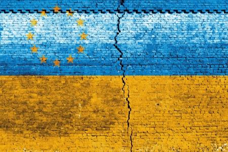 Cracked brick wall as Ukraine flag, symbolize the recent people strike Stock Photo - 24313843