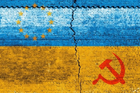 Cracked brick wall as Ukraine flag, symbolize the recent people strike Stock Photo - 24313844