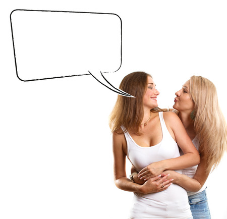Gay couple, two women looking on camera with speech bubble Stock Photo - 25024347