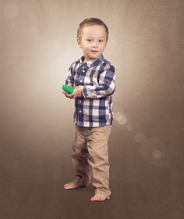 Hipster baby boy with toys in his hands photo