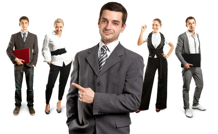 Business team against different backgrounds Stock Photo - 29394013