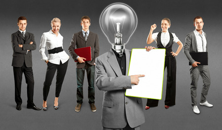 Idea concept. Lamp Head and Business team against different backgrounds Stock Photo - 30144635