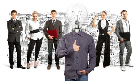 Idea concept. Lamp Head and Business team against different backgrounds Stock Photo - 30144637