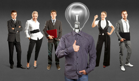 Idea concept. Lamp Head and Business team against different backgrounds Stock Photo - 30144639