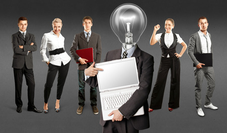 Idea concept. Lamp Head and Business team against different backgrounds Stock Photo - 30144642
