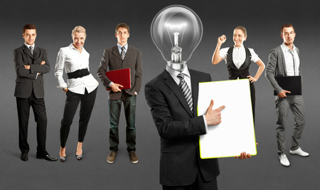 Idea concept. Lamp Head and Business team against different backgrounds Stock Photo - 30161213