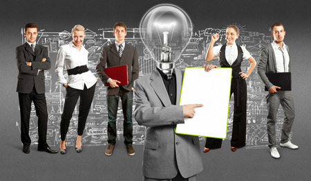Idea concept. Lamp Head and Business team against different backgrounds Stock Photo - 30644530