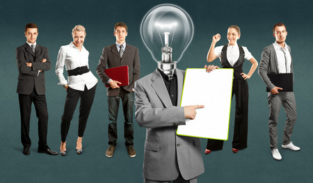 Idea concept. Lamp Head and Business team against different backgrounds Stock Photo - 30644531