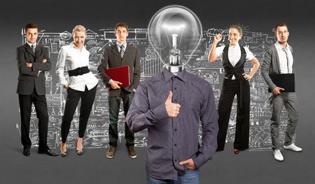Idea concept. Lamp Head and Business team against different backgrounds Stock Photo - 30644529