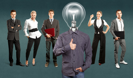 Idea concept. Lamp Head and Business team against different backgrounds Stock Photo - 30644532