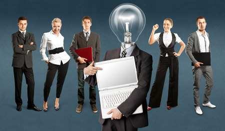 Idea concept. Lamp Head and Business team against different backgrounds Stock Photo - 30644533