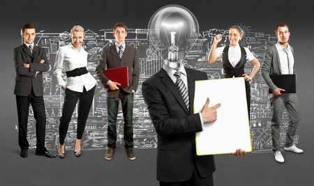 Idea concept. Lamp Head and Business team against different  Stock Photo - 30644571