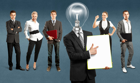 Idea concept. Lamp Head and Business team against different  Stock Photo - 30644572