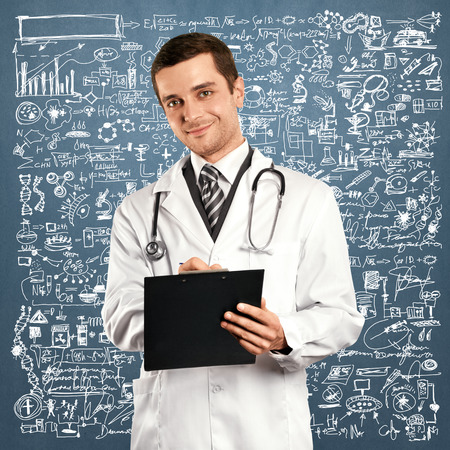 Doctor man writing something with marker on glass Stock Photo - 31023083