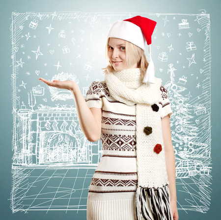 Woman with Santas hat waiting for Christmas, with open hand photo