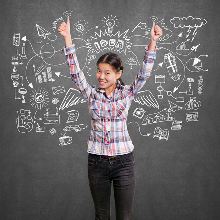 draw well: Winning idea concept. Asian girl shows well done with both hands
