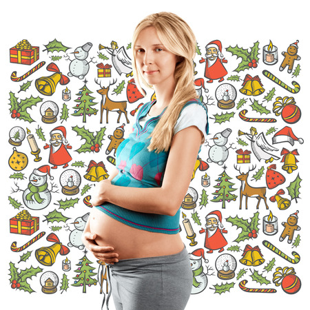 Pregnant woman looking for Christmas gifts and choosing it photo