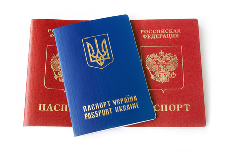 martial law: Ukrainian and Russian ID passports isolated on white background Stock Photo