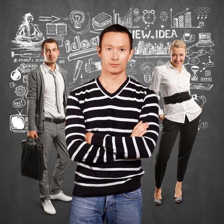 folded hands: Teamwork concept. Asian man in striped pullovert, looking on camera, with folded hands Stock Photo