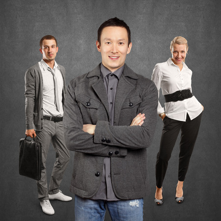 folded hands: Teamwork concept. Asian man in suit, looking on camera, with folded hands