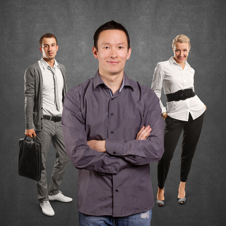 folded hands: Teamwork concept. Asian man smiling, looking on camera, with folded hands Stock Photo