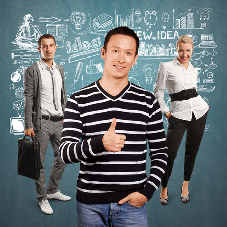 well done: Teamwork concept. Asian man in striped pullovert, showing well done Stock Photo