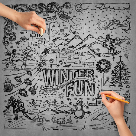 winter fun: Idea winter fun background sketch and human hand with pencil Stock Photo