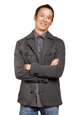 folded hands: Asian man smiling, looking on camera, with folded hands
