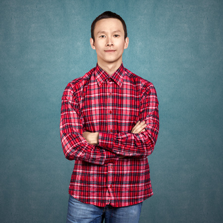 folded hands: Asian man looking on camera, with folded hands