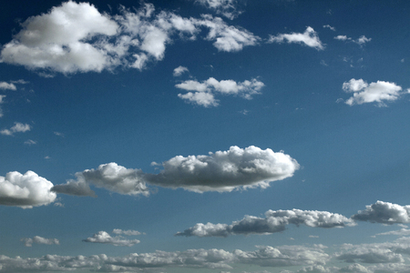 Blue sky with clouds. White sunny clouds on the sky