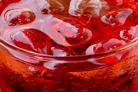 Refreshment  Bubble, Fizz and Ice in a glass in a Red Liquid photo