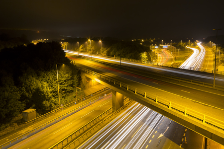 trails of lights: Long exposure of the M25 motorway. The long exposure cause light trails from the lights of the vehicles. Stock Photo