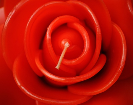 Beautiful close up red rose candle   photo