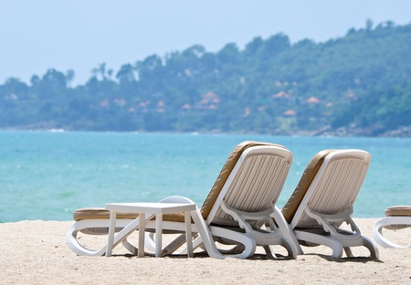 White sand beach and beach chairs photo