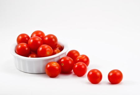 Red cherry tomatoes in white bowl Stock Photo - 13959113