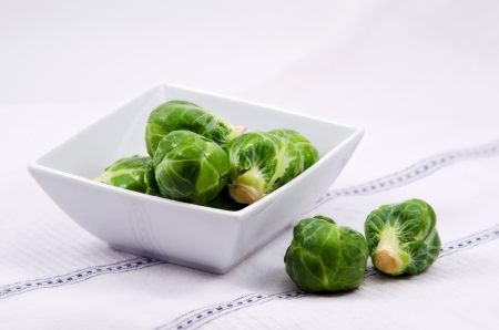Fresh Brussels Sprouts in white bowl