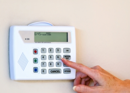 home safety: Setting home security alarm Stock Photo