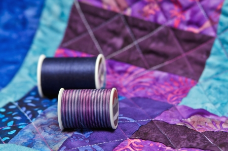 Closeup of quilt and quilting thread photo