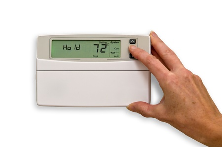 Adjusting thermostat  Stock Photo