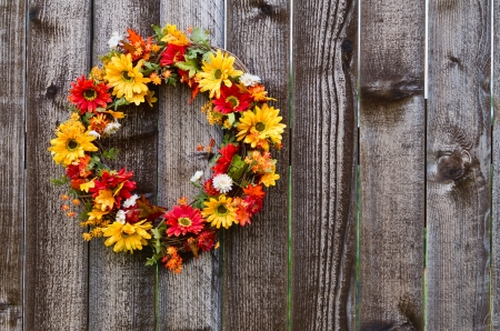 Autumn flower wreath on rustic wooden fence Stock Photo - 15292028